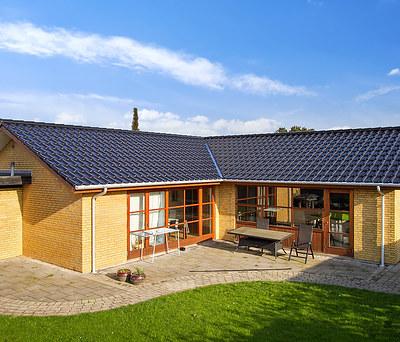 Nyt 202 m2 tegltag fra Komproment og Plastmo tagrender til hus i Odense